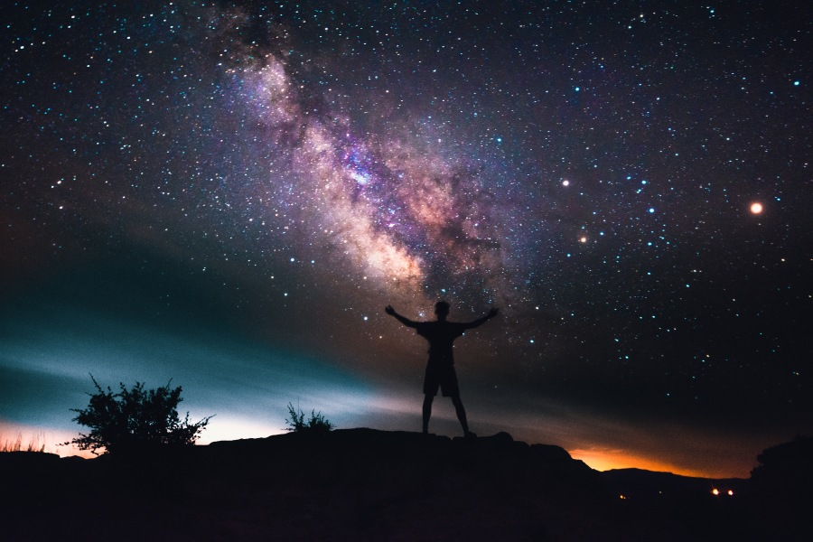 Man Looking Up At Stars